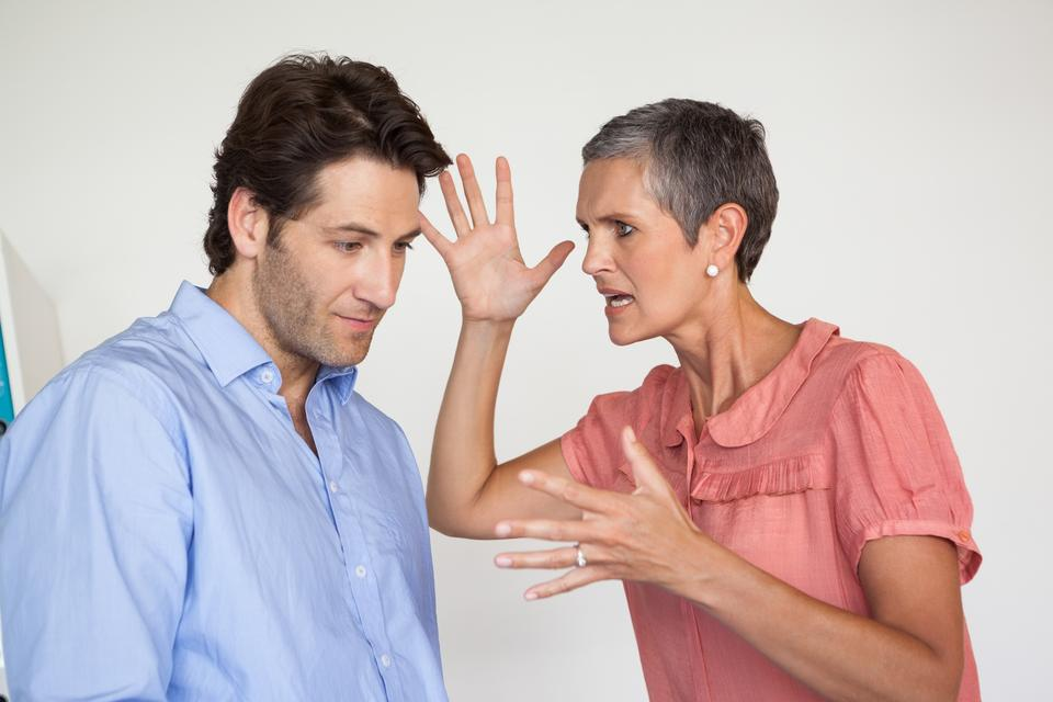 """""""Angry businesswoman shouting at employee"""" stock image"""