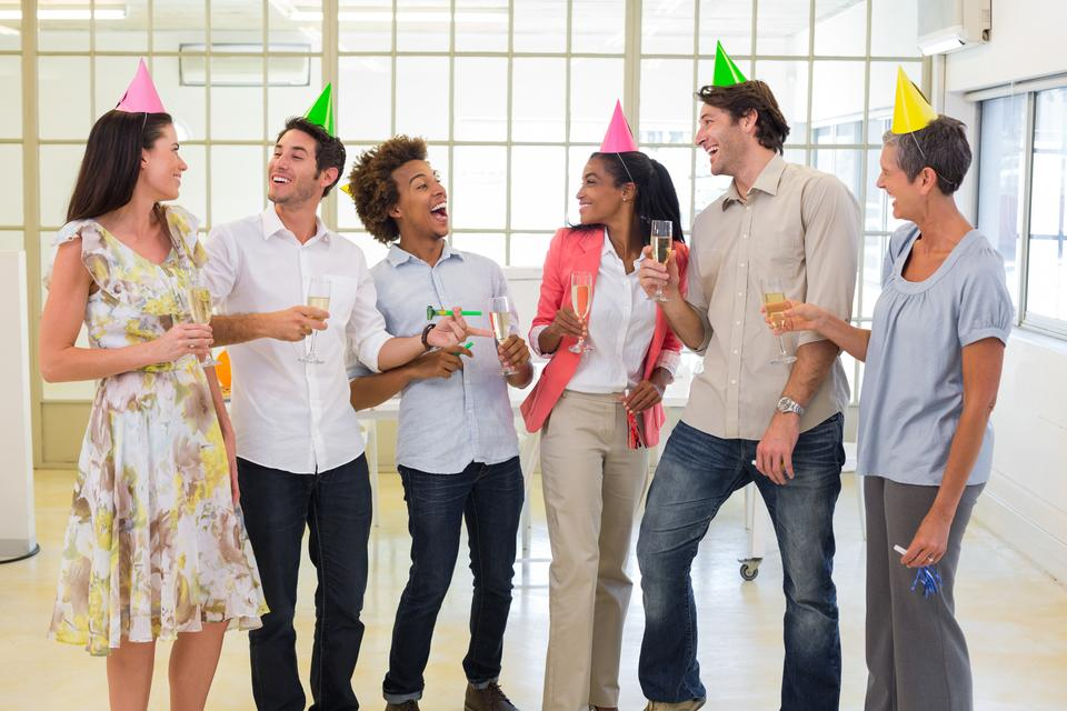 """""""Coworkers laugh and celebrate accomplishment and enjoy party"""" stock image"""