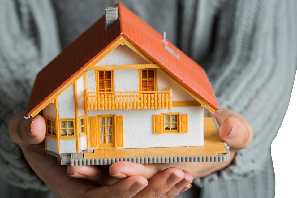 """""""Hands showing a miniature model home"""" stock image"""