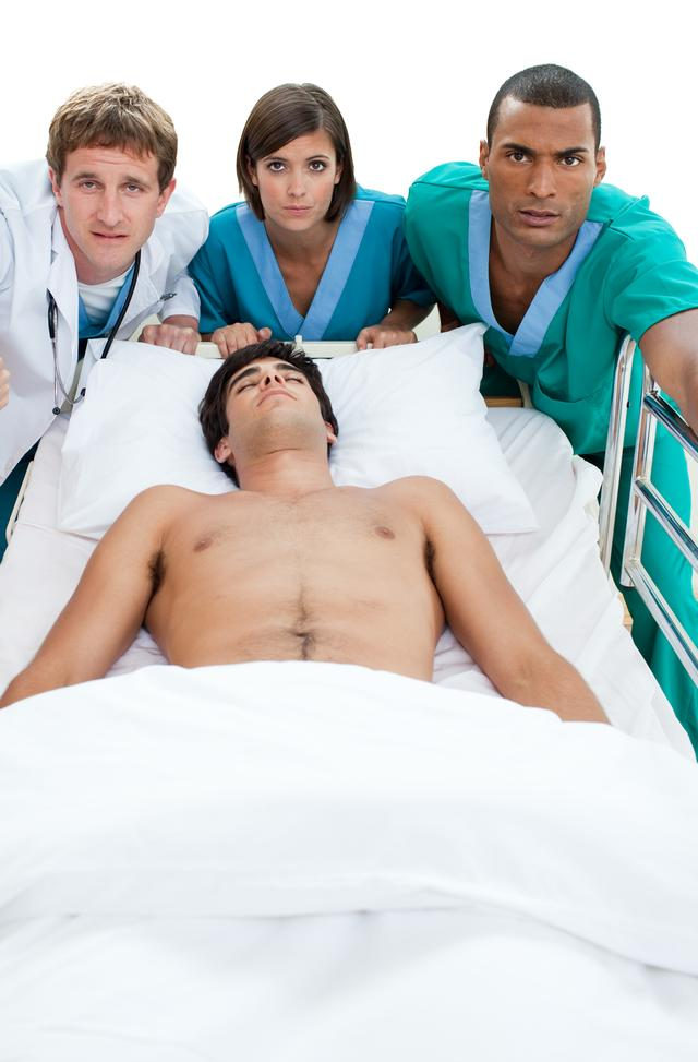 """""""Emergency scene: medical team carriyng a patient"""" stock image"""