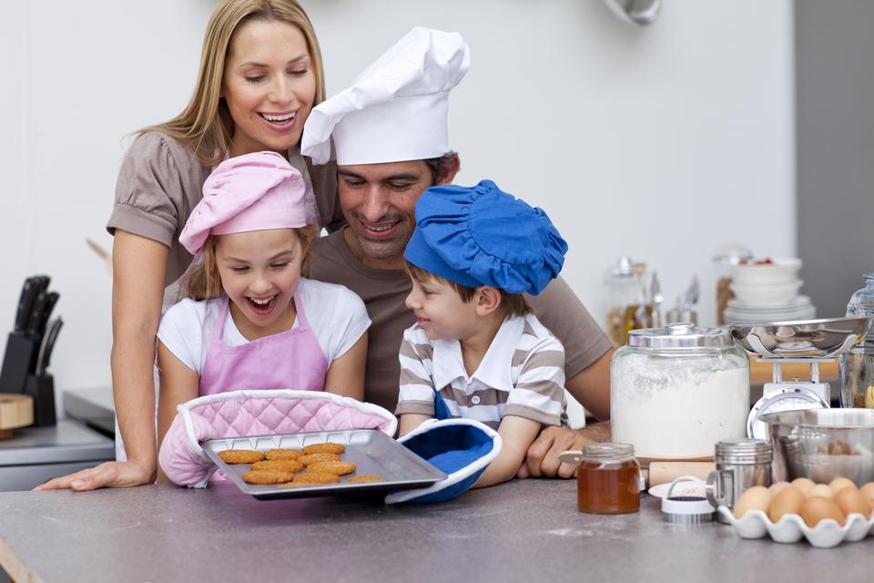 """""""Happy family baking cookies in the kitchen"""" stock image"""