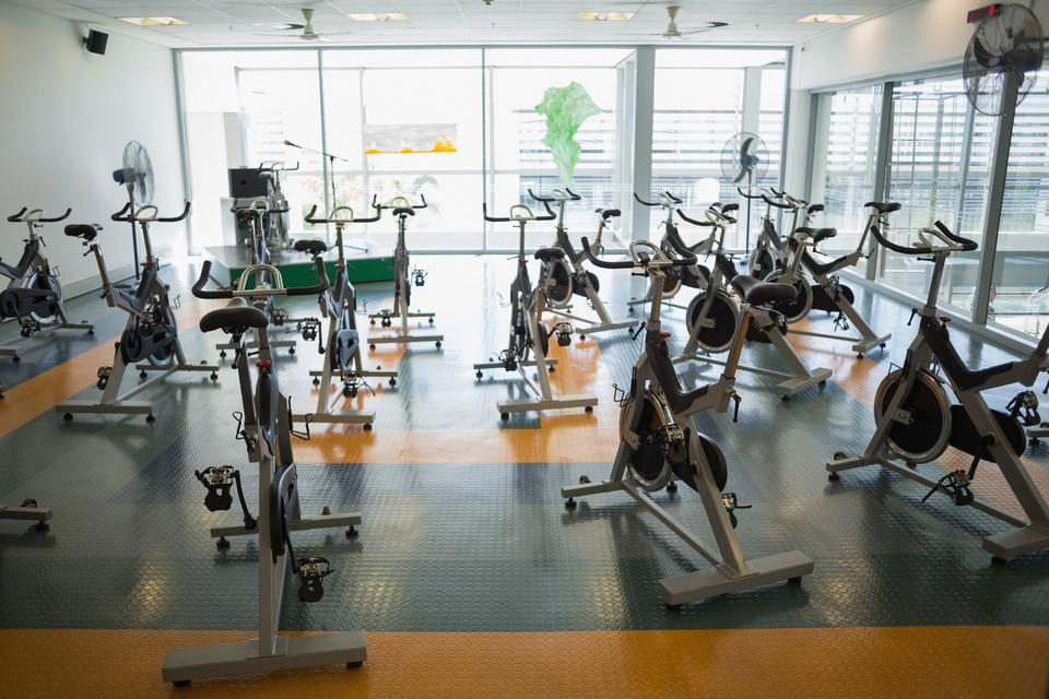 """""""Large empty fitness studio with spin bikes"""" stock image"""