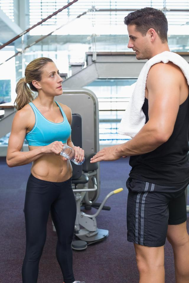 """""""Bodybuilding man and woman talking together"""" stock image"""