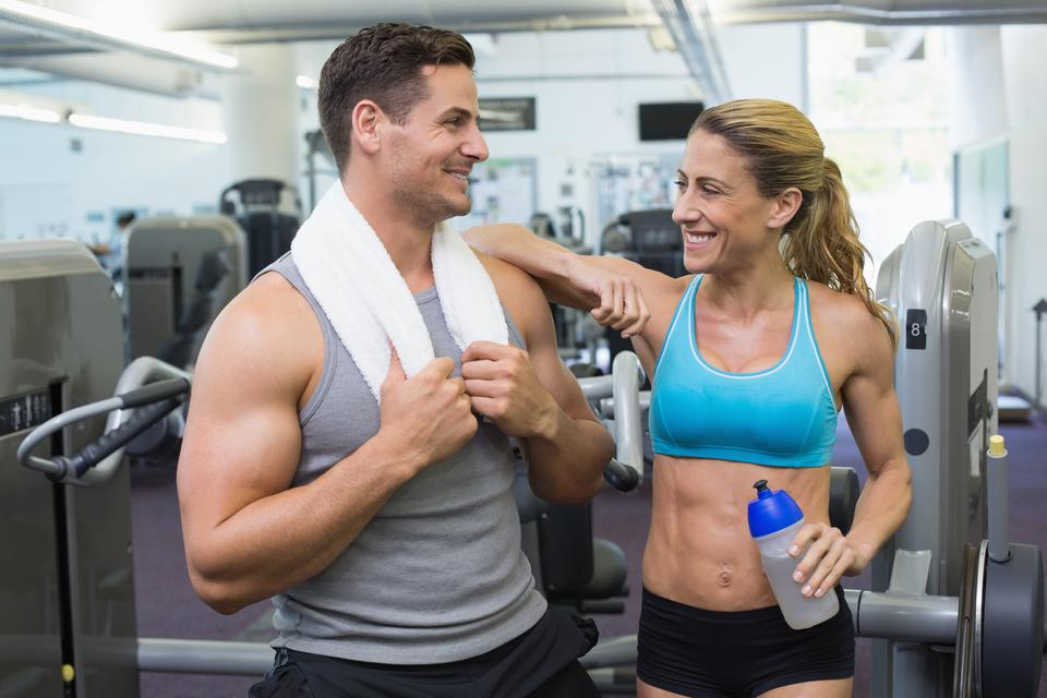 """""""Bodybuilding man and woman chatting together"""" stock image"""