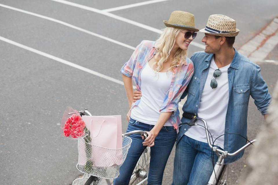 """""""Hip young couple going for a bike ride"""" stock image"""