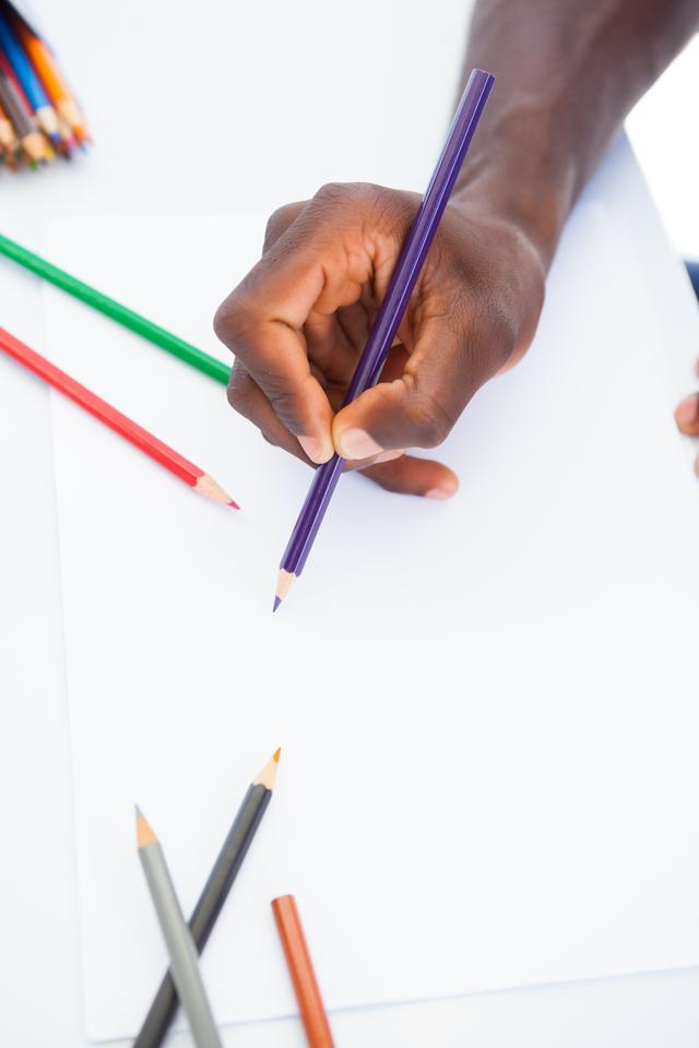 """""""Man colouring with purple pencil"""" stock image"""
