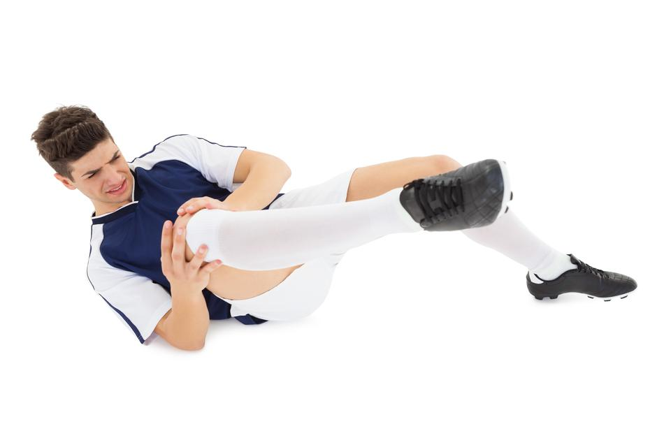 """Football player lying down injured"" stock image"