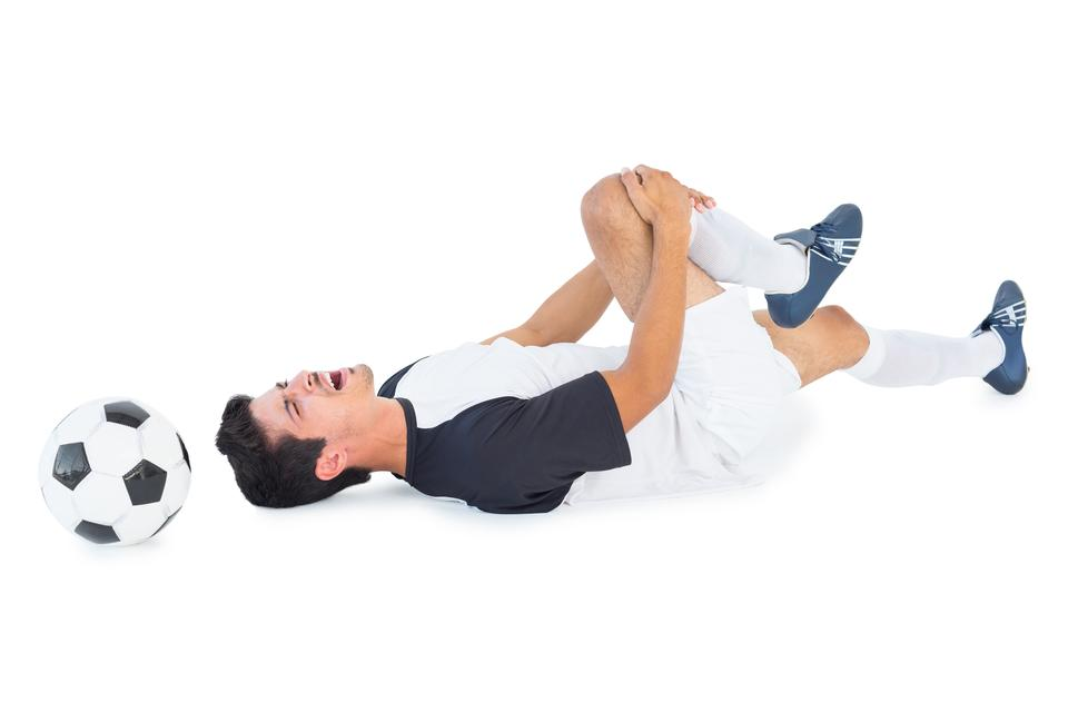 """Football player in white lying injured"" stock image"
