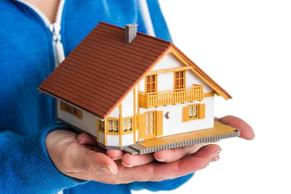 """""""Hands holding miniature house model"""" stock image"""
