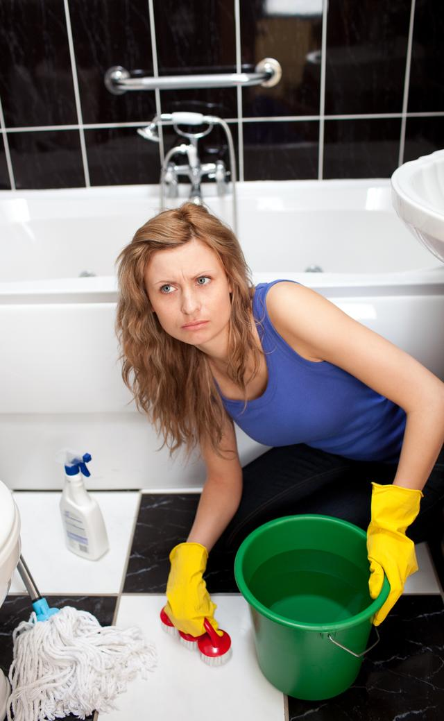 """Angry woman in a bathroom"" stock image"