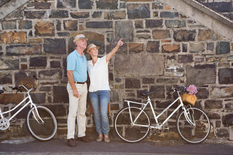 """""""Happy senior couple going for a bike ride in the city"""" stock image"""