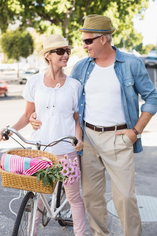"""""""Happy mature couple going for a bike ride in the city"""" stock image"""