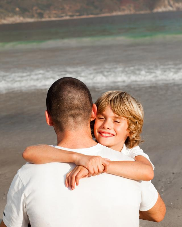 """""""Portrait of a cute Boy Hugging his father"""" stock image"""