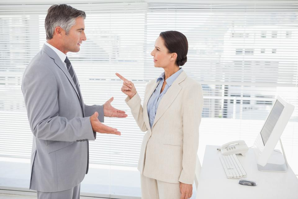 """Businesswoman arguing with co worker"" stock image"