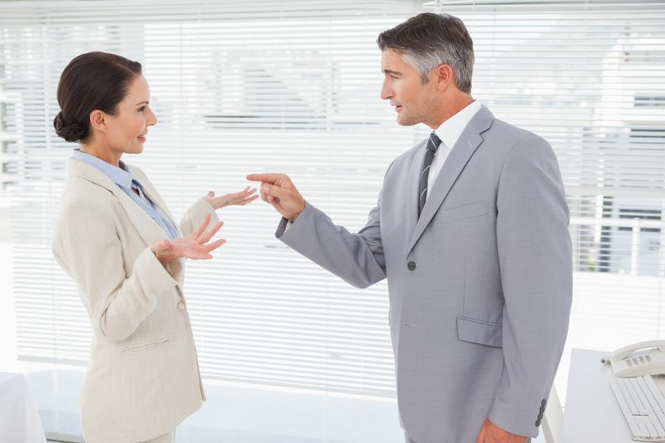 """Businessman scolding his co worker"" stock image"