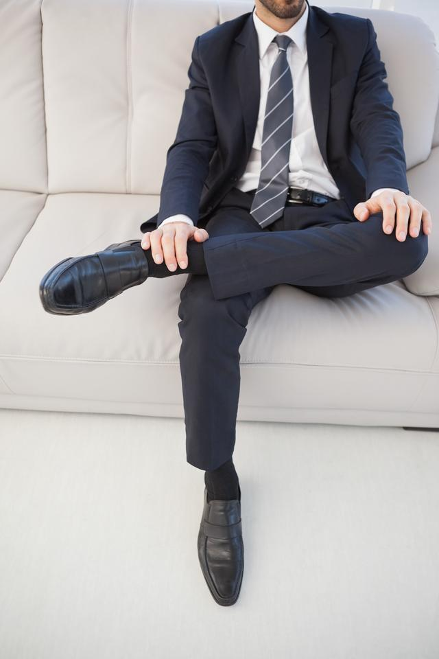 """Businessman with leg on his knee"" stock image"