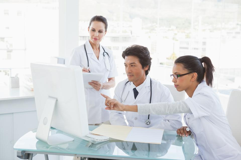 """""""Doctors looking at the computer monitor"""" stock image"""