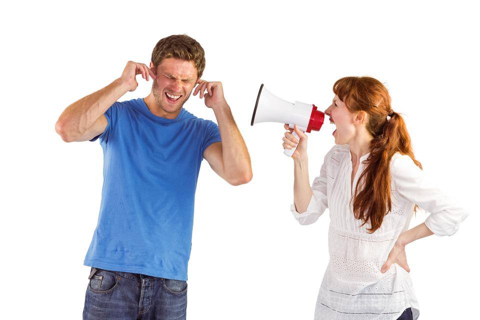 """Woman shouting through a megaphone"" stock image"