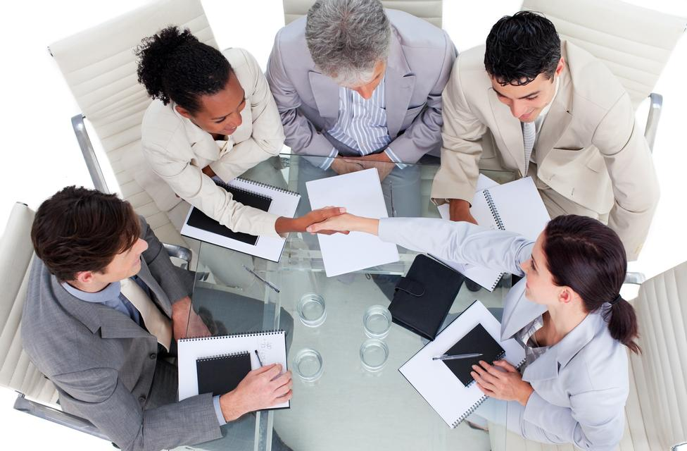 """""""Cute business team closing a deal"""" stock image"""