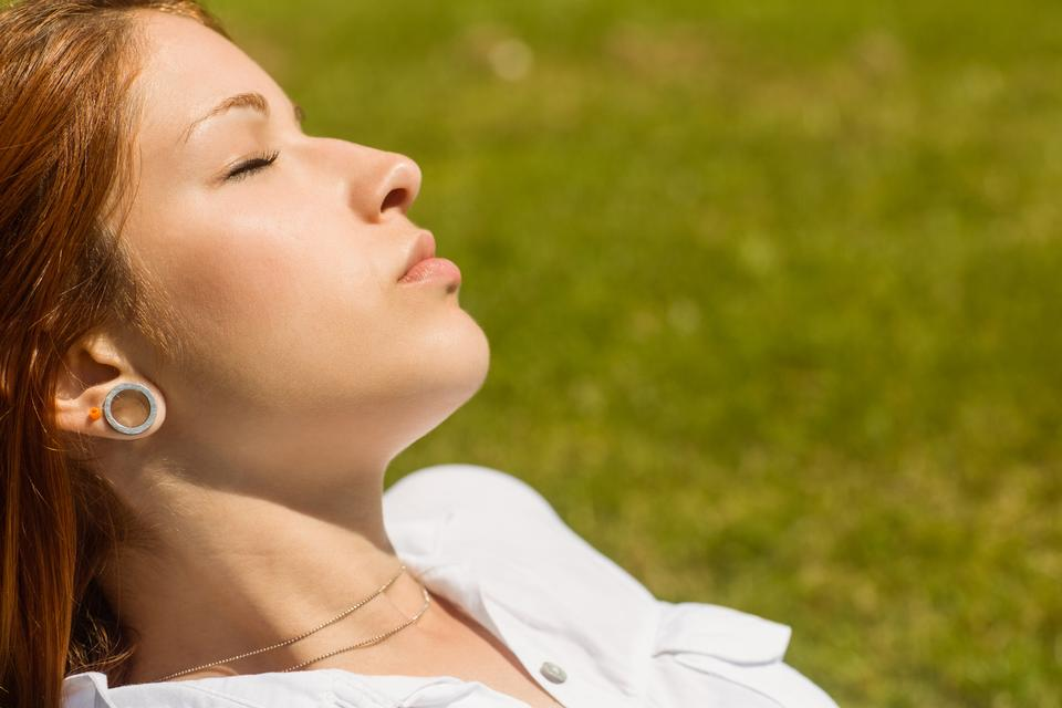 """""""Pretty redhead lying with her eyes closed"""" stock image"""