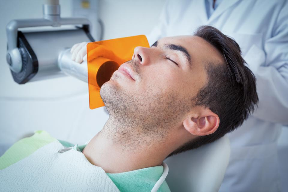 """Young man undergoing dental checkup"" stock image"