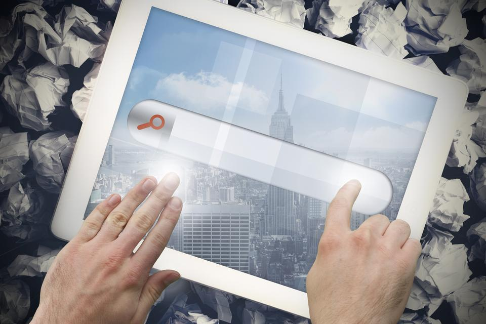 """""""Hands touching search bar on tablet screen"""" stock image"""
