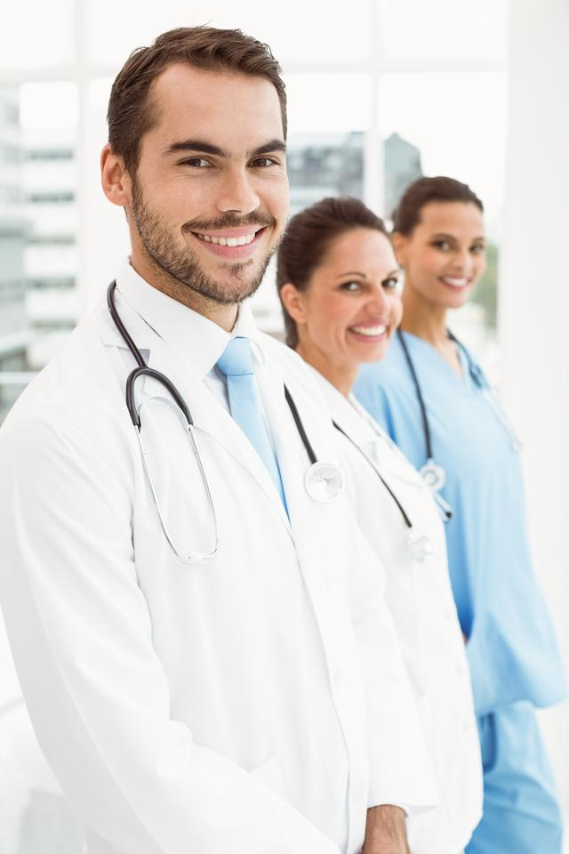 """""""Smiling doctors at medical office"""" stock image"""