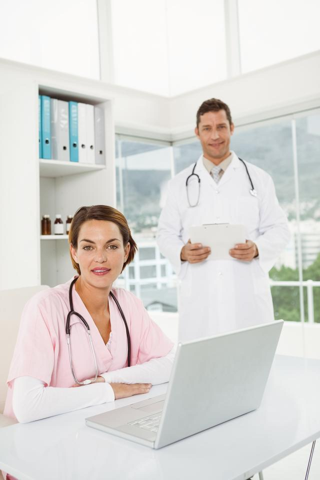 """""""Confident doctors at medical office"""" stock image"""