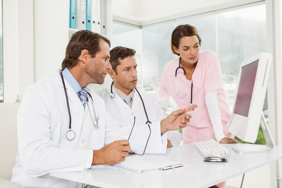 """""""Doctors using computer at medical office"""" stock image"""
