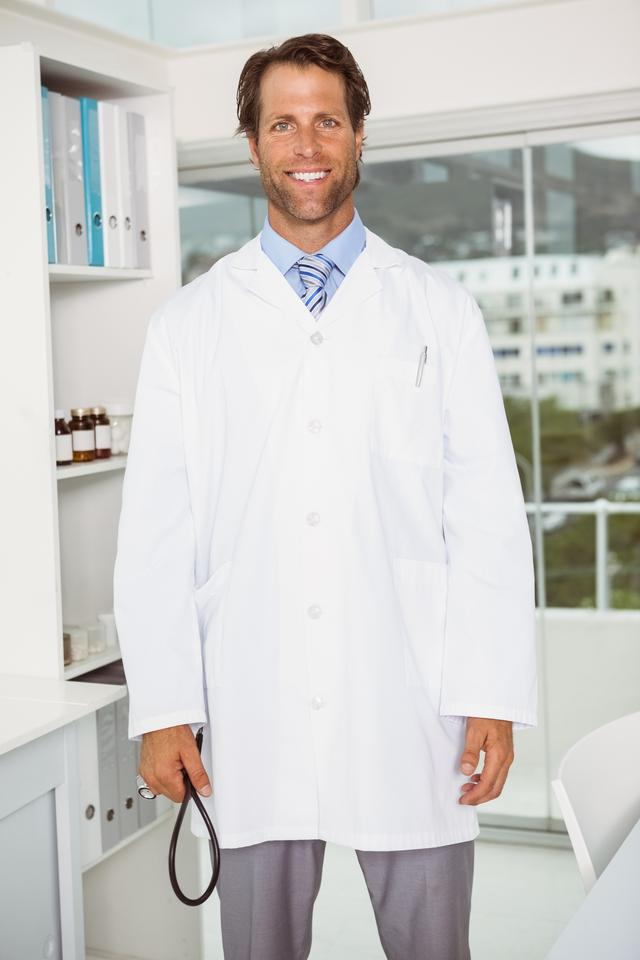"""""""Confident male doctor in medical office"""" stock image"""