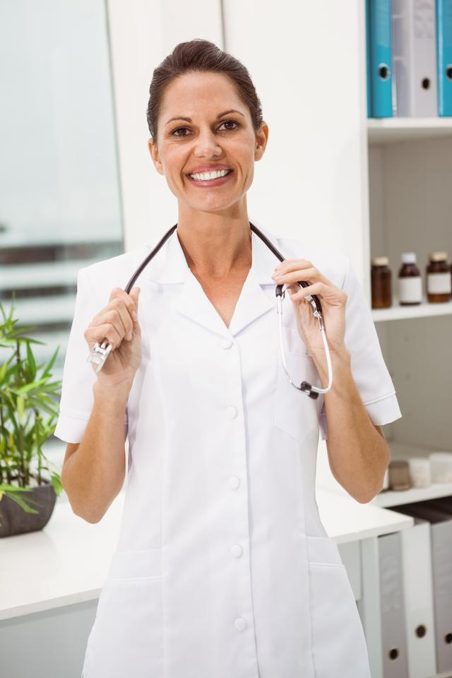 """""""Female doctor with stethoscope at medical office"""" stock image"""