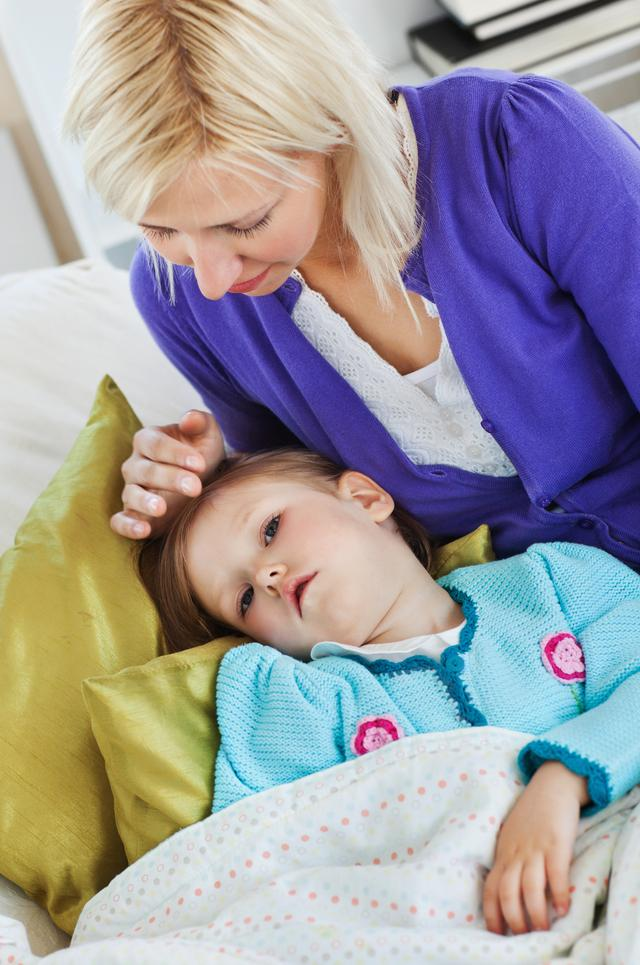 """""""Sick cute child lying on couch"""" stock image"""