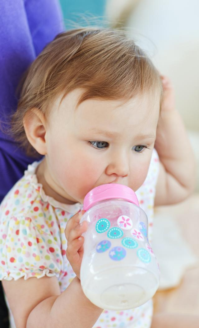 """""""Young girl drinking"""" stock image"""
