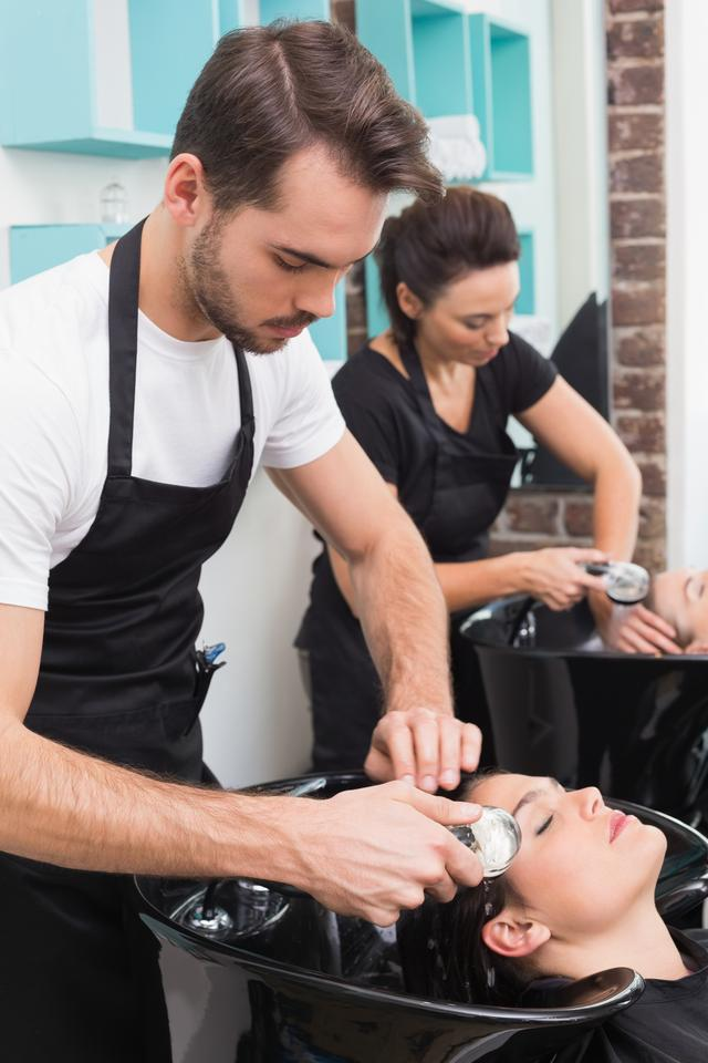 """""""Hairdressers washing their clients hair"""" stock image"""