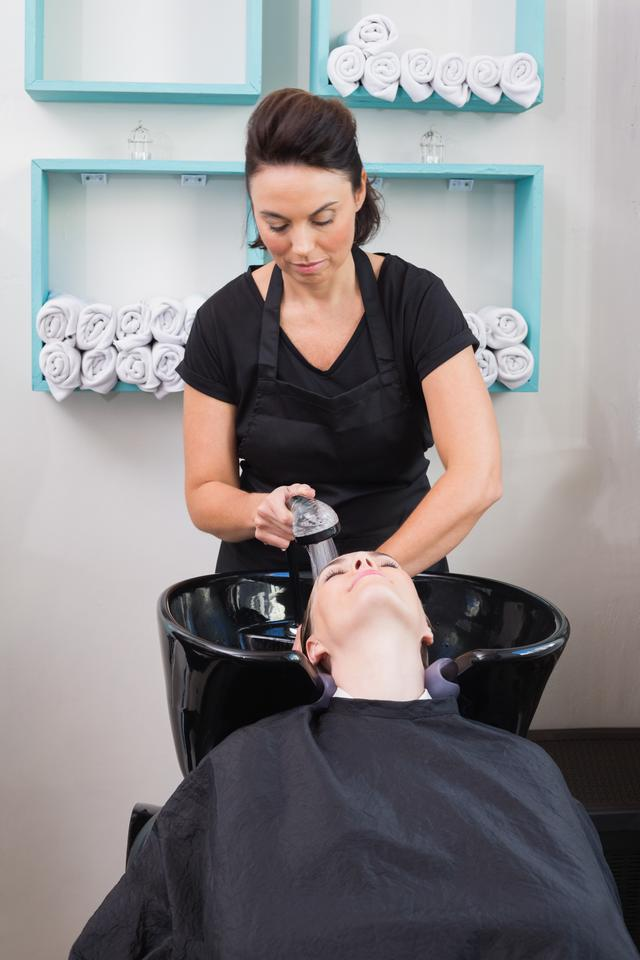"""""""Hairdresser washing clients hair"""" stock image"""