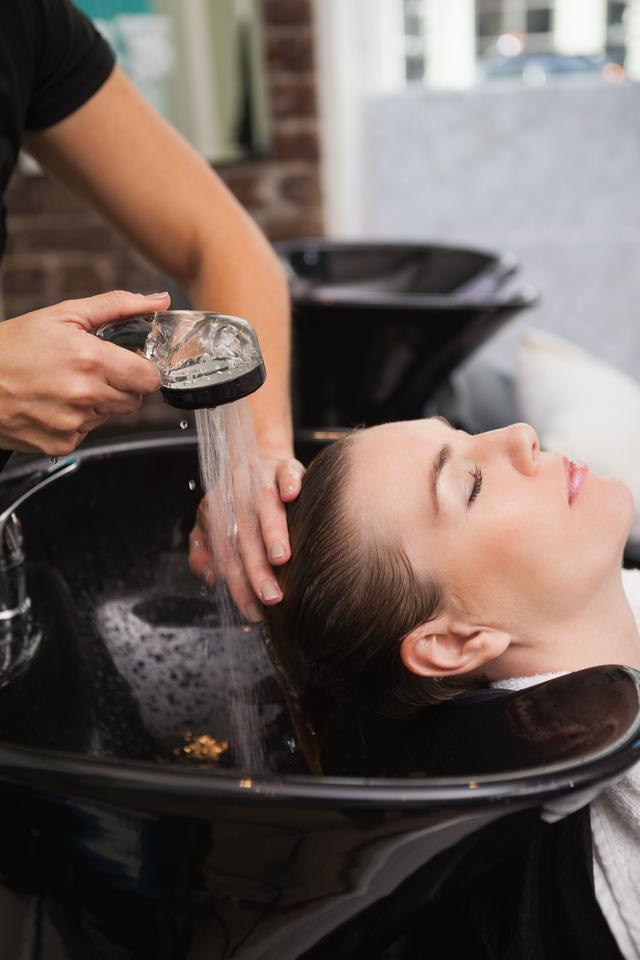 """""""Customer getting their hair washed"""" stock image"""
