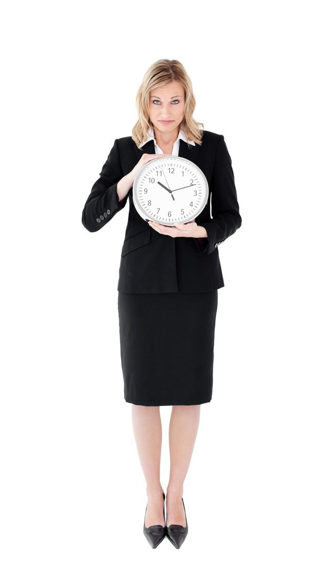 """Distressed businesswoman holding a clock"" stock image"