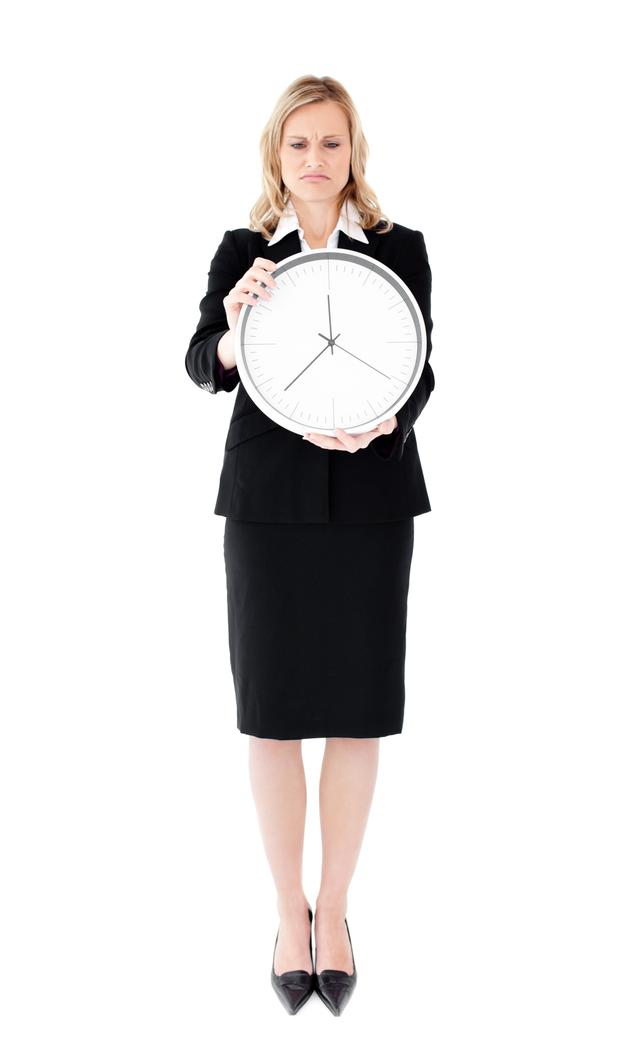 """Frustrated businesswoman holding a clock"" stock image"