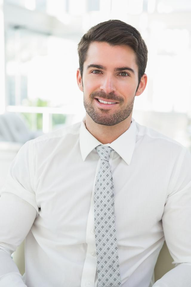 """Portrait of a smiling businessman well dressed"" stock image"