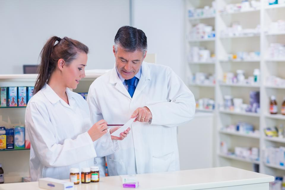 """Pharmacist and his trainee working together"" stock image"