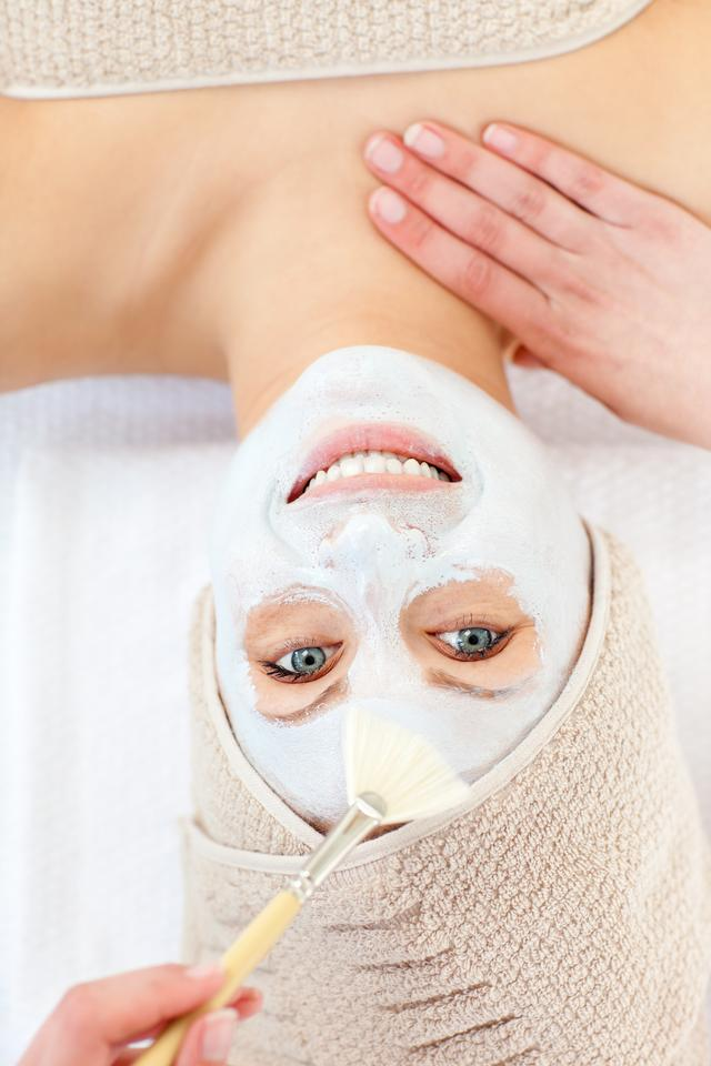 """""""Captivating woman having white cream on her face"""" stock image"""