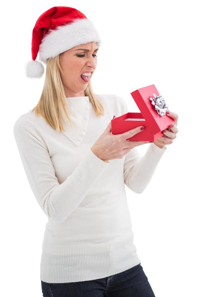 """""""Disappointed blonde opening christmas gift"""" stock image"""
