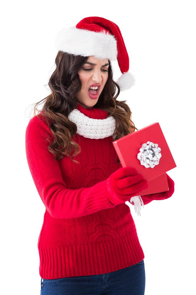 """""""Disappointed brunette opening christmas gift"""" stock image"""