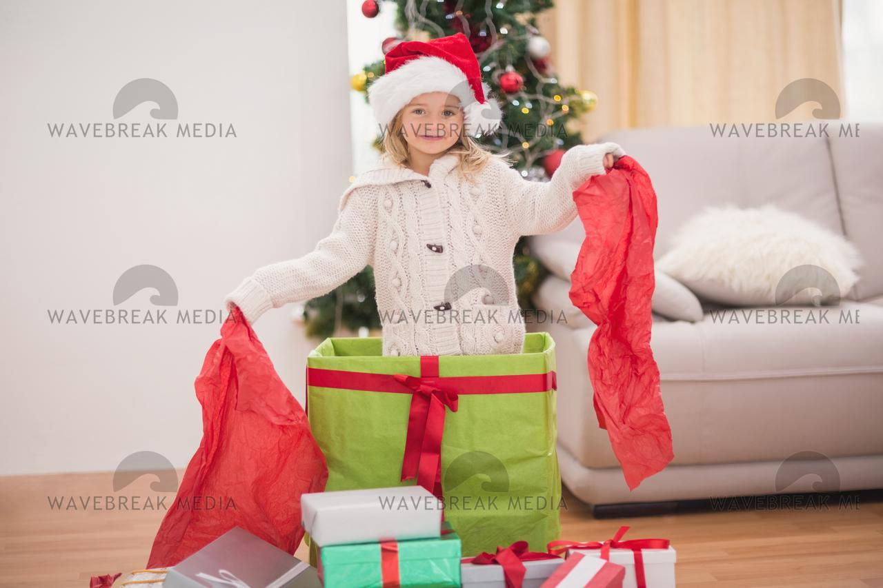Cute little girl sitting in giant christmas gift - License for ...