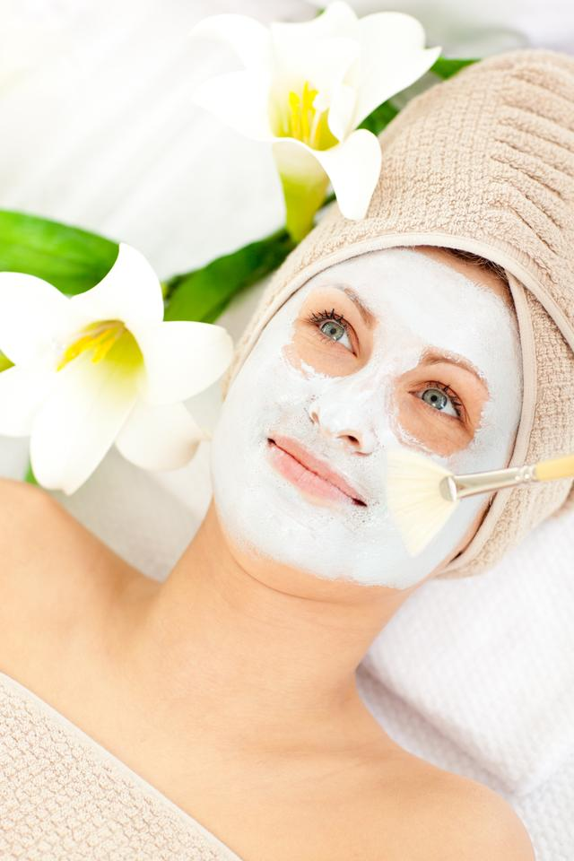"""""""Captivating young woman receiving white cream on her face"""" stock image"""