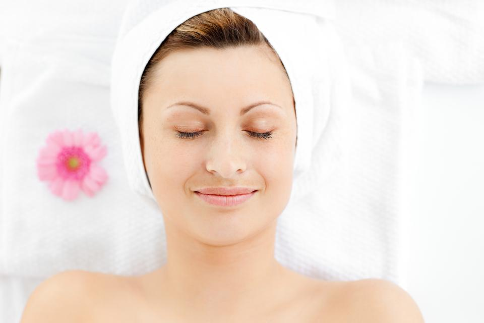 """""""Portrait of a captivating young woman resting on a massage table"""" stock image"""