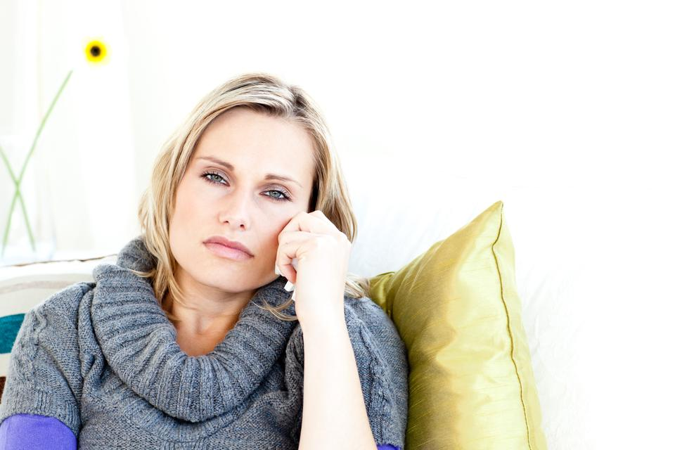 """""""Portrait of a depressed woman lying on a sofa"""" stock image"""