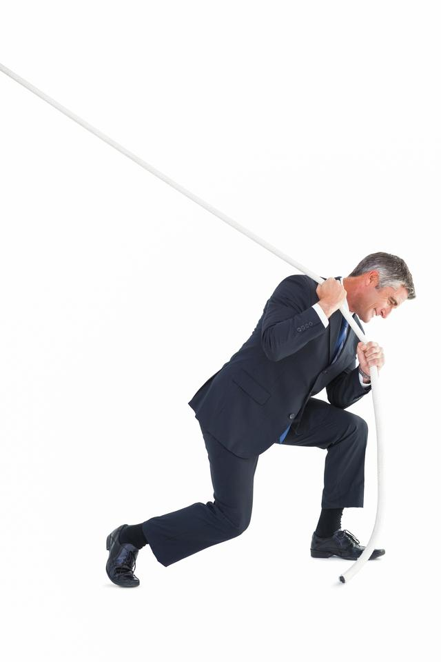 """Classy businessman pulling a rope"" stock image"