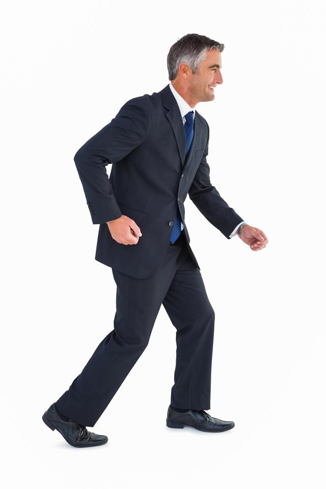 """Smiling businessman well dressed posing"" stock image"