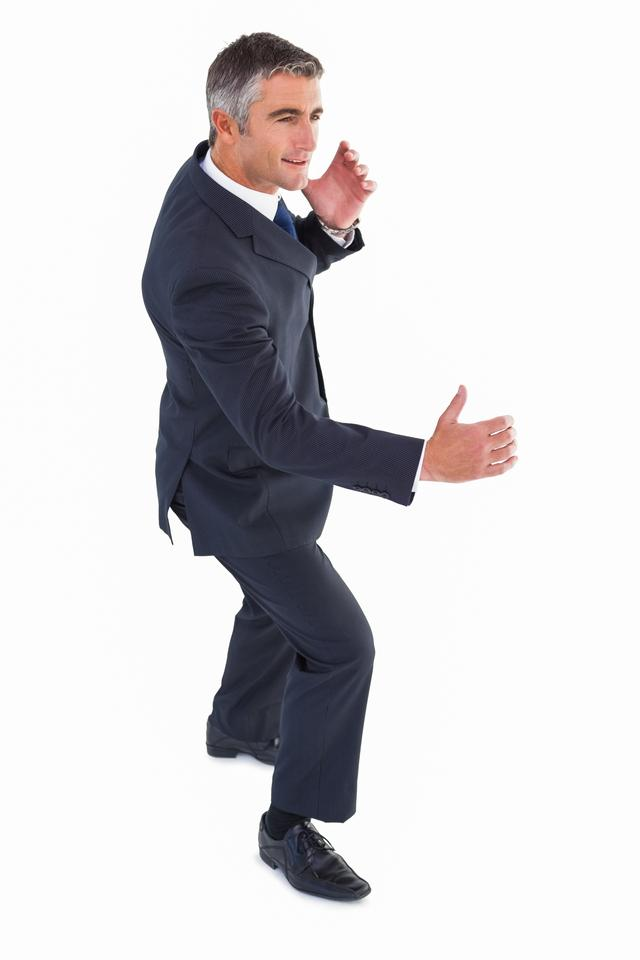"""Cheerful businessman well dressed posing"" stock image"
